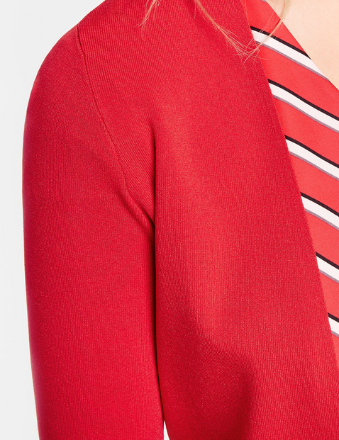 Knit bolero with 3/4-length sleeves