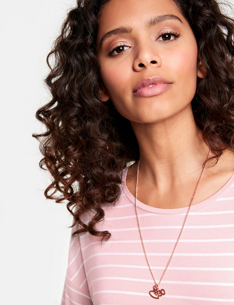 Striped top with a detachable necklace