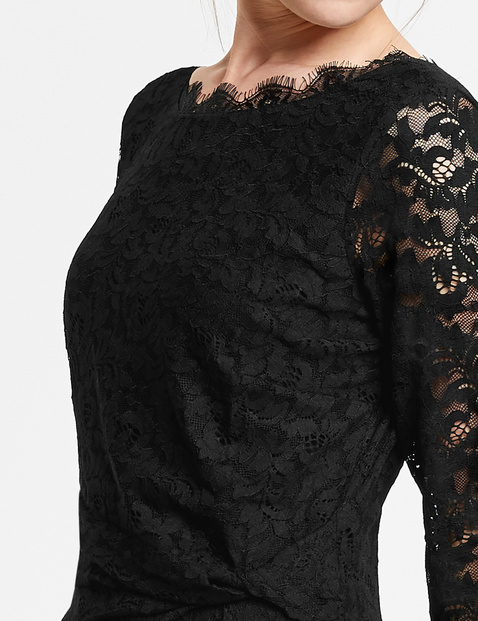 Lace dress with side draping