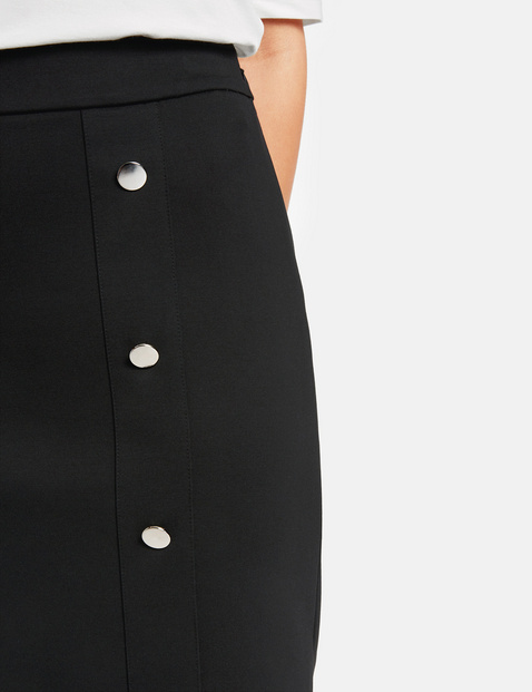 Pencil skirt with a decorative button placket