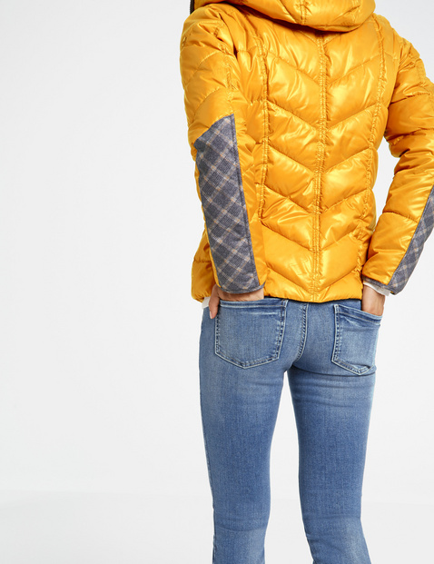 Shiny quilted jacket with a hood