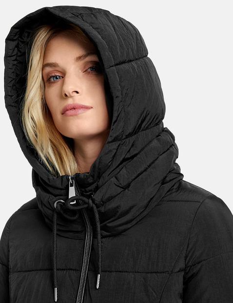 Pikowany płaszcz z podszewką w panterkę