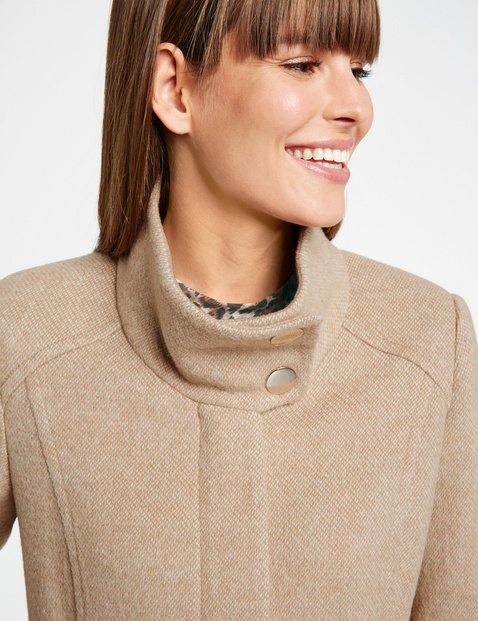 Short coat with a stand-up collar