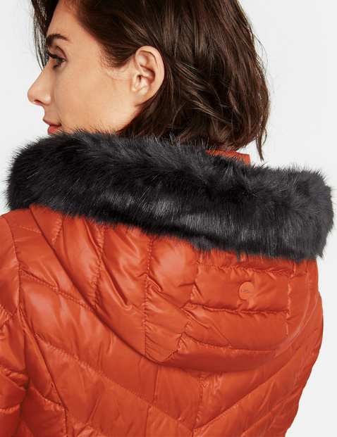 Quilted jacket with a faux fur collar