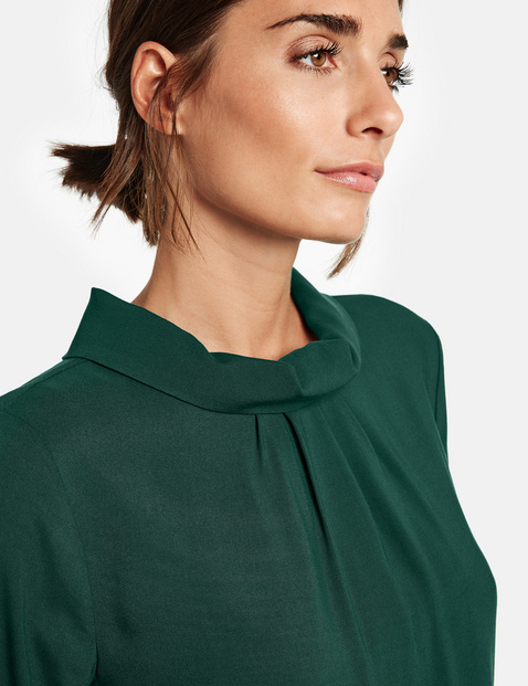 Blouse top with a stand-up collar