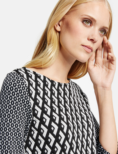 3/4-sleeve top with a mixed pattern