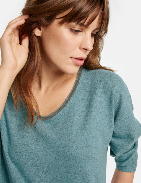 3/4-sleeve top with a decorative trim