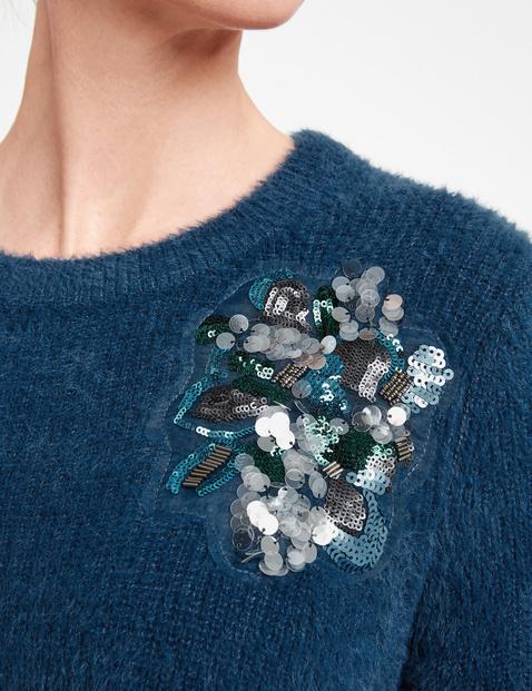 Sweter z aplikacjami