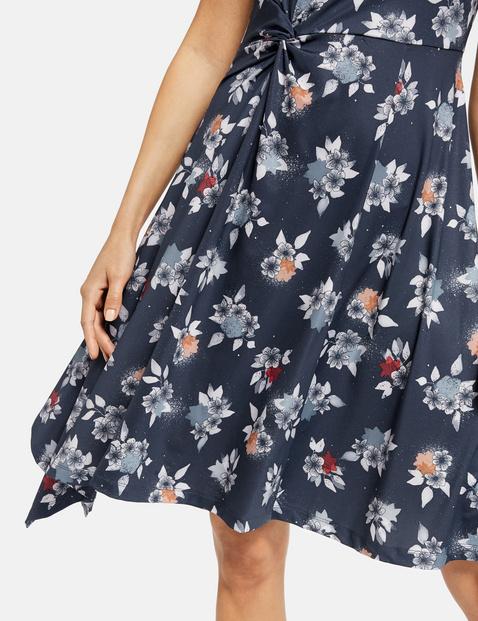 Jersey dress with an asymmetric hem