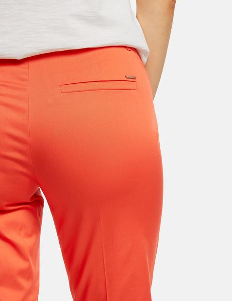 Gepflegte 7/8 Hose mit High-Low-Saum Slim Peg Leg