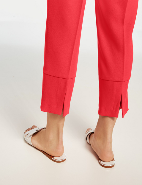 7/8-length peg trousers with a tie-around belt