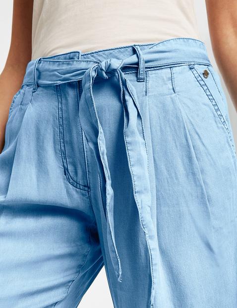 Modne spodnie z wiązanym paskiem w dżinsowym stylu