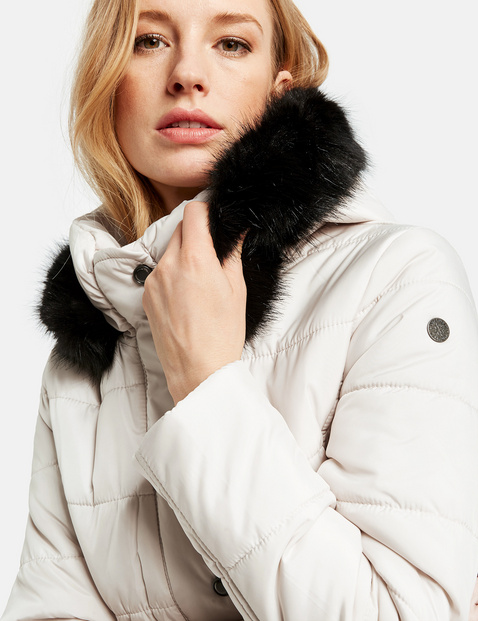 Quilted jacket with a hood and a faux fur collar