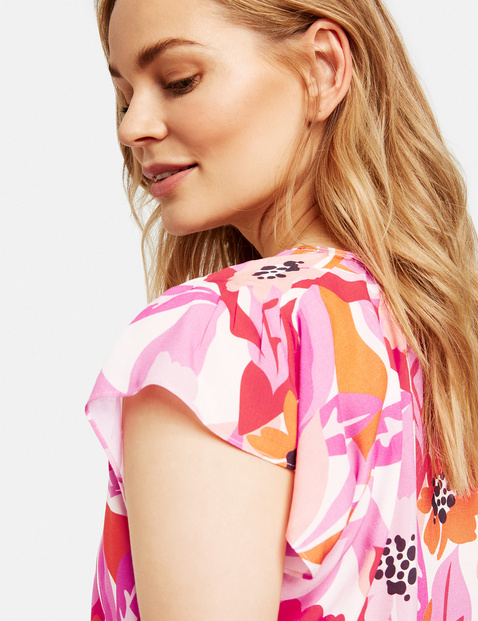 Krótka bluzka z kwiatowym nadrukiem