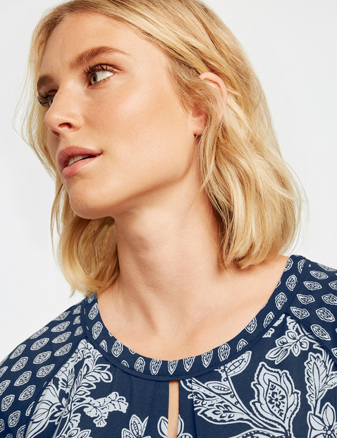 Blouse top with cap sleeves