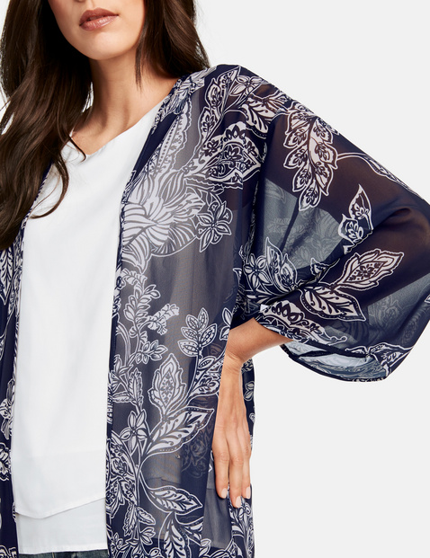 Open-fronted long blouse with a floral print