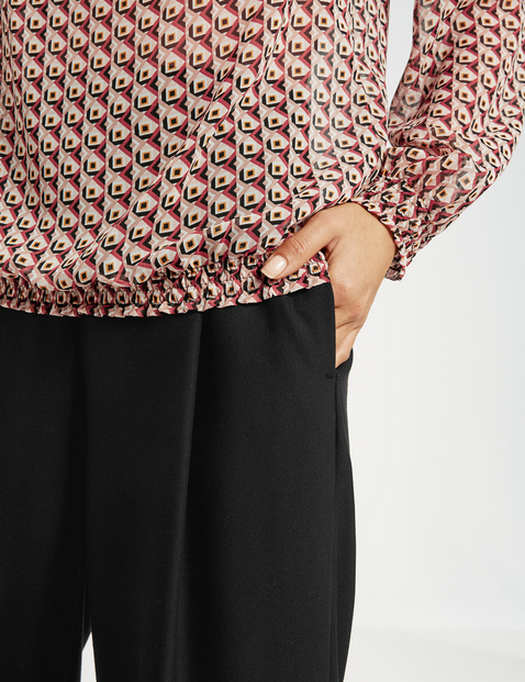 Blouse top with stretchy edges