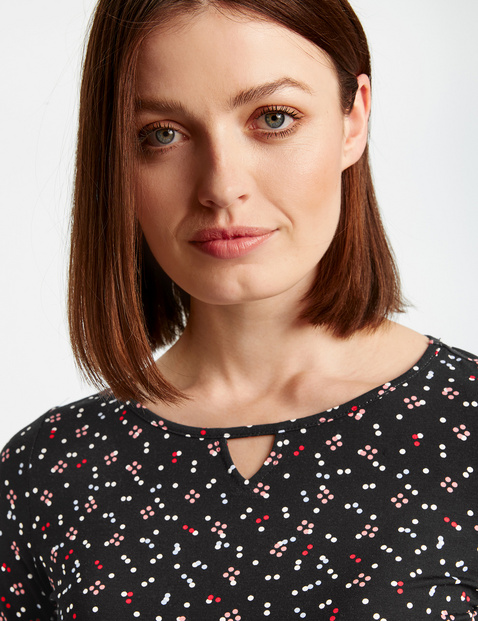 3/4-sleeve top with a polka dot print