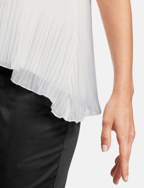 Flared pleated blouse top
