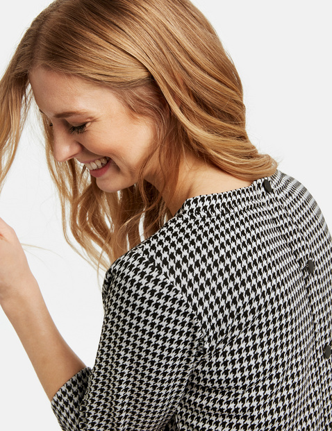 Top with 3/4-length sleeves and houndstooth checks