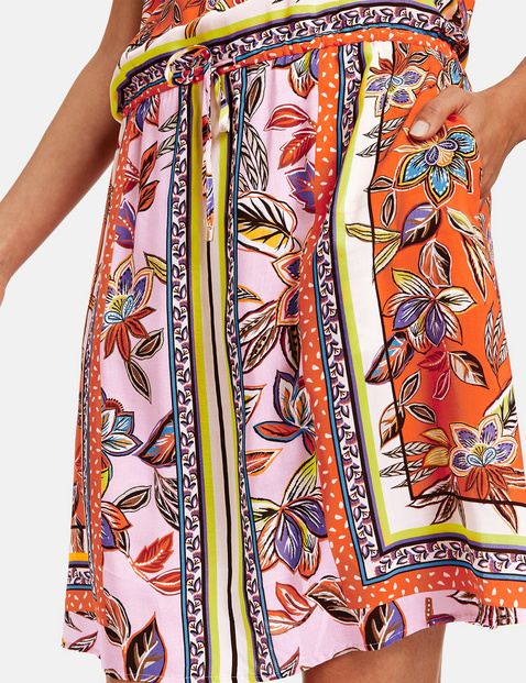 Summer dress with an expressive scarf print