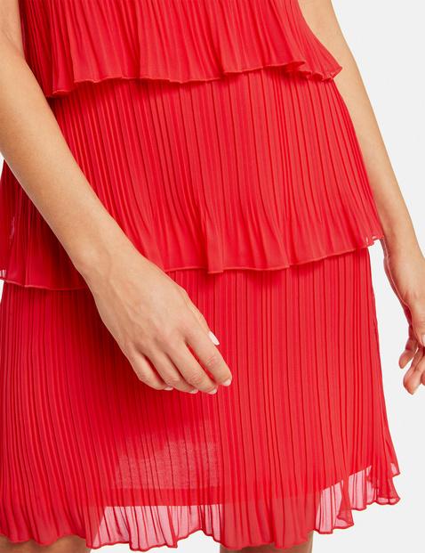 Geplisseerde jurk