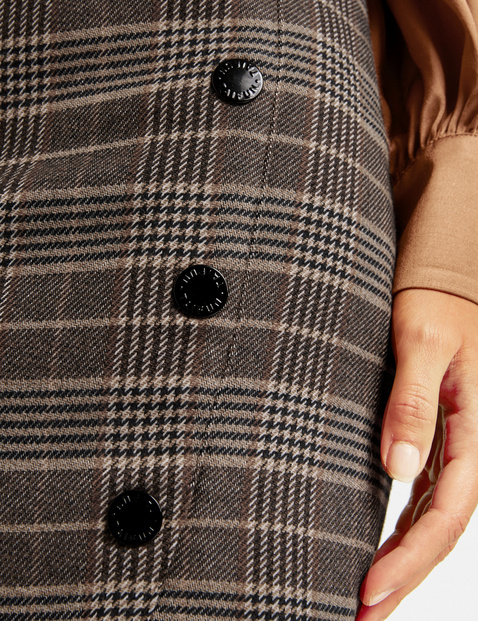 Checked skirt with a button placket