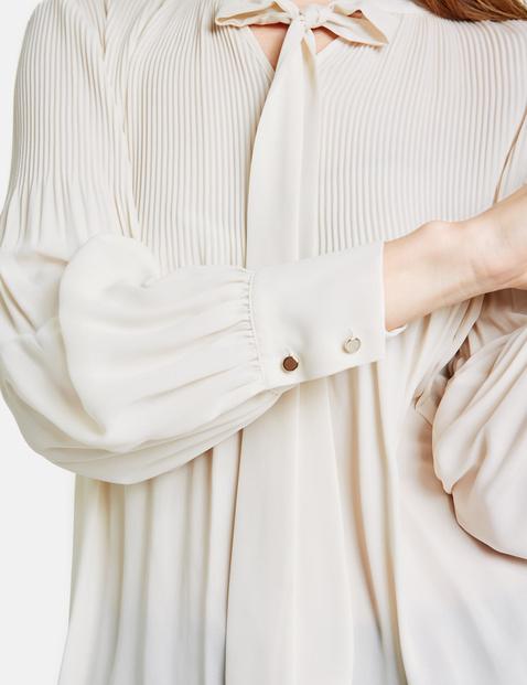Geplisseerde blouse met striklint