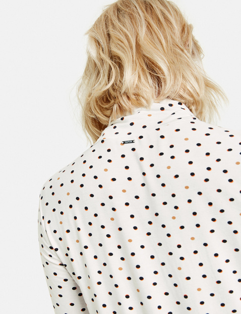 Long sleeve top with an all-over polka dot pattern