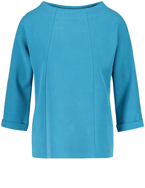 3/4-sleeve top with a deep stand-up collar