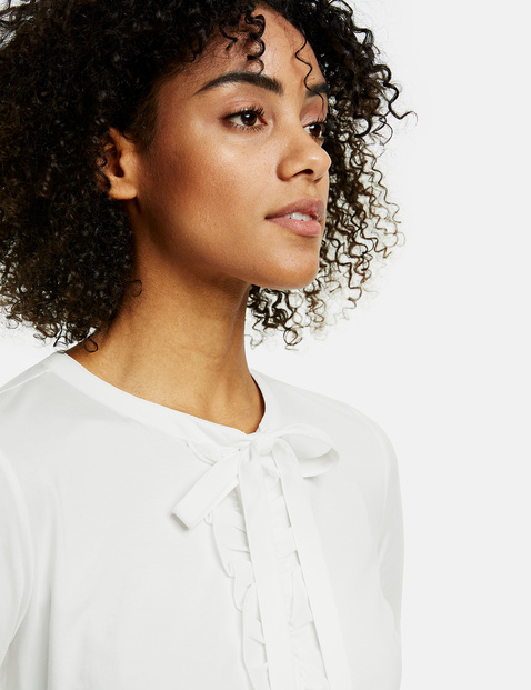 Blouse top with ruffles