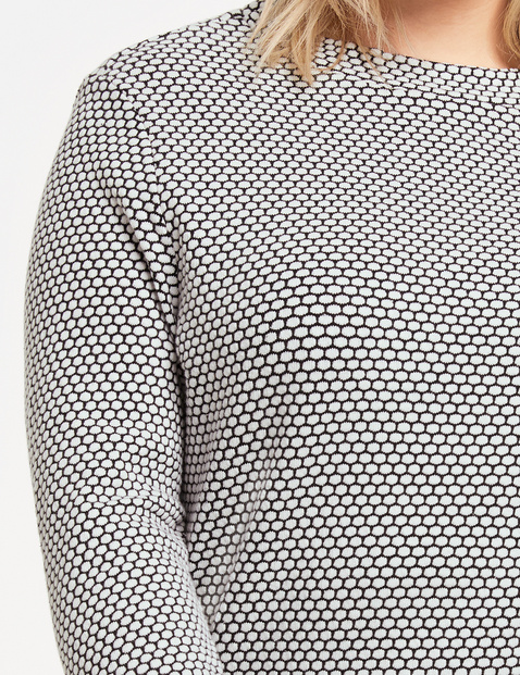 Long sleeve top with a textured pattern