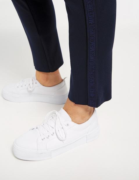 Dżersejowe spodnie z kontrastowymi paskami