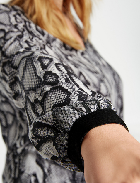 Tunic with a snakeskin print