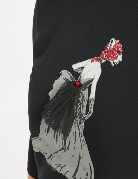 Koszulka z napisem i ozdobami