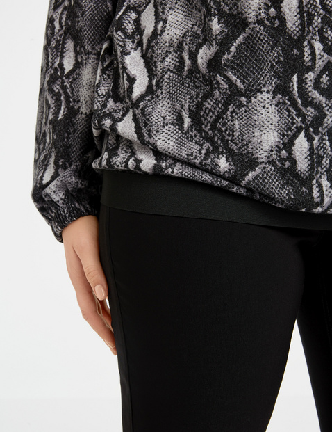Top with a snakeskin print