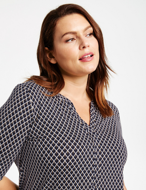 Flared mid-length sleeve top
