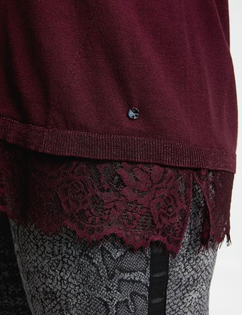 Ausgestellter Pullover mit Spitzenbordüre