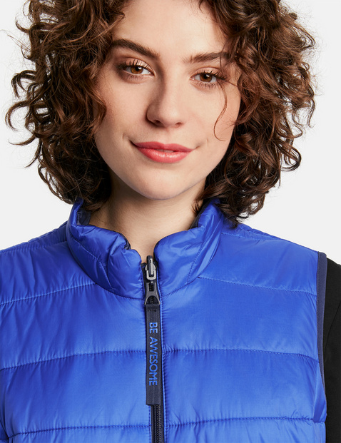 Reversible quilted body warmer