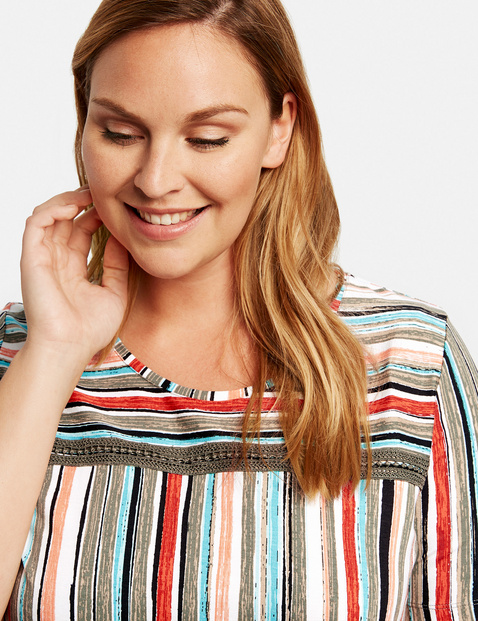 Top with multi-coloured stripes