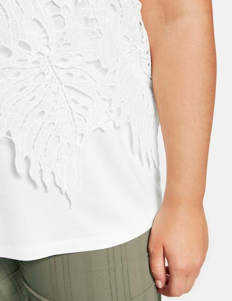 Blouseachtig shirt met opengewerkt borduursel