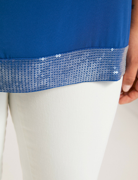 Formal blouse with a sequin hem