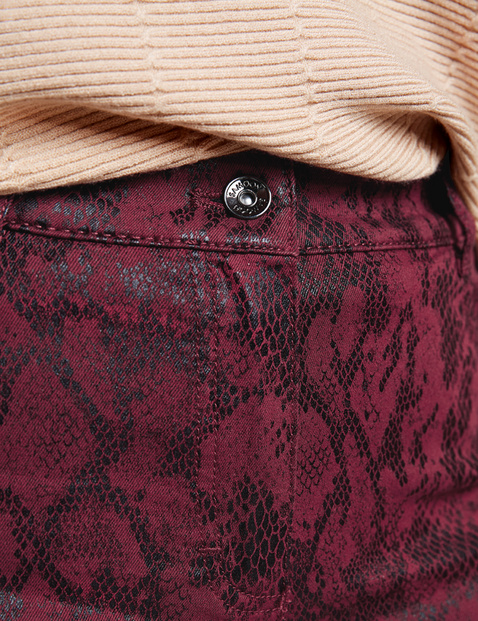 Trousers with a shiny snake print