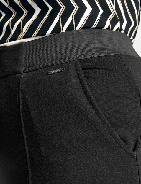 Boot cut trousers with an elasticated waistband