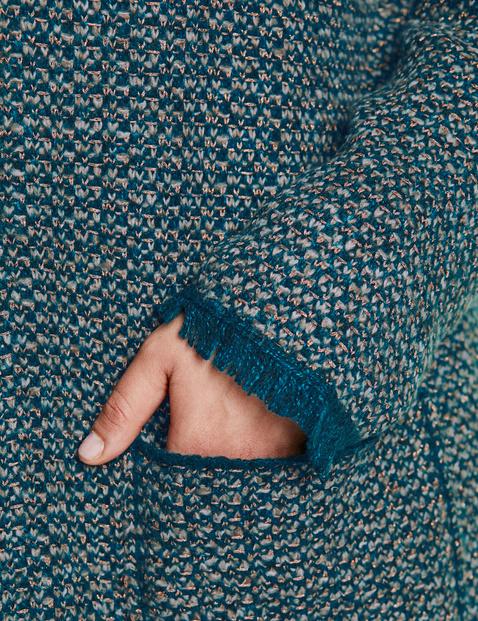 Cardigan with fringed edges