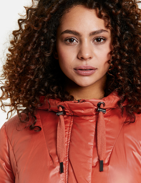 Flared quilted jacket