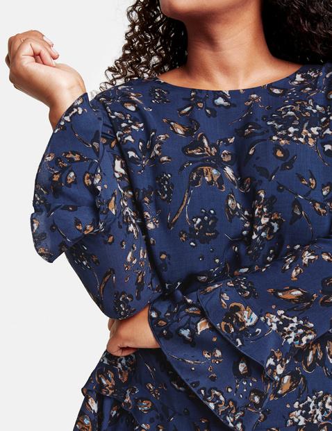 Uitlopende blouse met volants