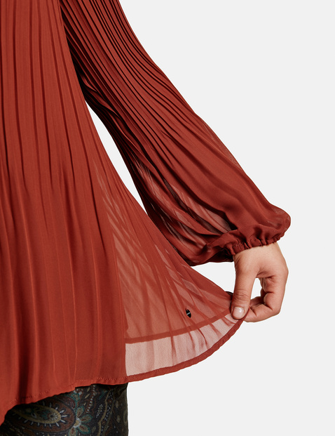 Slightly flared pleated blouse