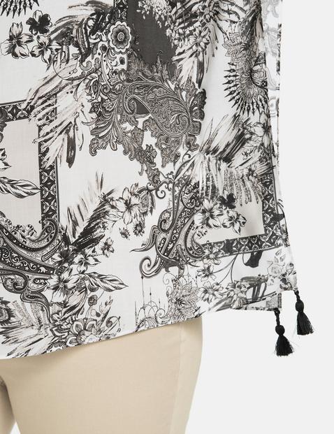 Bluzkowe ponczo z chwostami