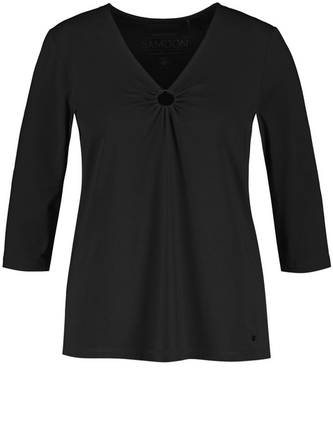 3/4 sleeve top with a ring insert